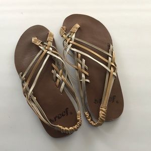 Gold and silver strappy Reef sandals, size 8.